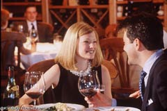 A couple dining in a restaurant; Actual size=240 pixels wide